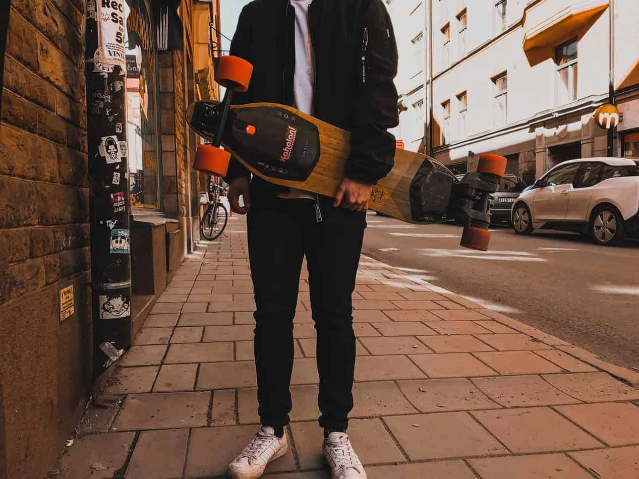 Person Holding Rimable bamboo drop through longboard